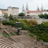 Dramatic Venue Photo: The preserved Roman theater and Basilica of Notre Dame de Fourviere in the distance in Lyon.