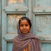 Door Girl Photo: A cute Indian girl stands in front of a worn front door in Bijapur, India (ARCHIVED PHOTO on the weekends - originally photographed 2009/02/22).