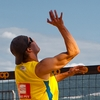 photo: Big Ups - A men's beach volleyball player jumps sky-high for a spike during a tournament sponsored by Coop in Geneva.