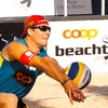 Dashing Digger Photo: A handsome men's beach volleyball player digs a spiked ball in at a Coop sponsored volleyball tournament in Geneva.