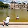 Park Play (before/after) Photo: A boy plays with a sailboat at the Jardin de Luxembourg in Paris.