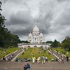 Stormy Heart (before/after) Photo: Stormy clouds form over Sacre Coeur Basilica atop Montmartre in Paris.