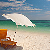 Power of One Photo: A lone beach chair and umbrella on a beautiful white sand beach on the Thai island of Ko Lipe (ARCHIVED PHOTO on the weekends - originally photographed 2007/03/12).