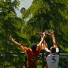 Pigskin Pile Photo: Opposing players are lifted for the ball at an amateur rugby tournament in America (ARCHIVED PHOTO on the weekends - originally photographed 2006/05/13).