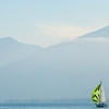 Solo Sailing Photo: A lone sailboat navigates Annecy Lake on a foggy morning.