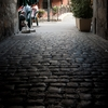 Rocky Road Photo: An ancient tunnel with cobblestone path in the old city in Annecy.