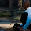 Stoney Servant Photo: A female Buddhist nun sits at the Bayon Temple in Angkor Wat in Cambodia (ARCHIVED PHOTO on the weekends - originally photographed 2007/05/18).